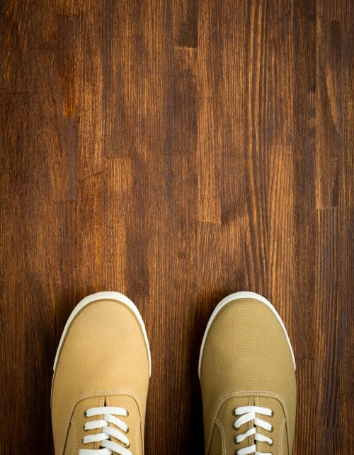 Trevelaing sneakers on wooden background close up